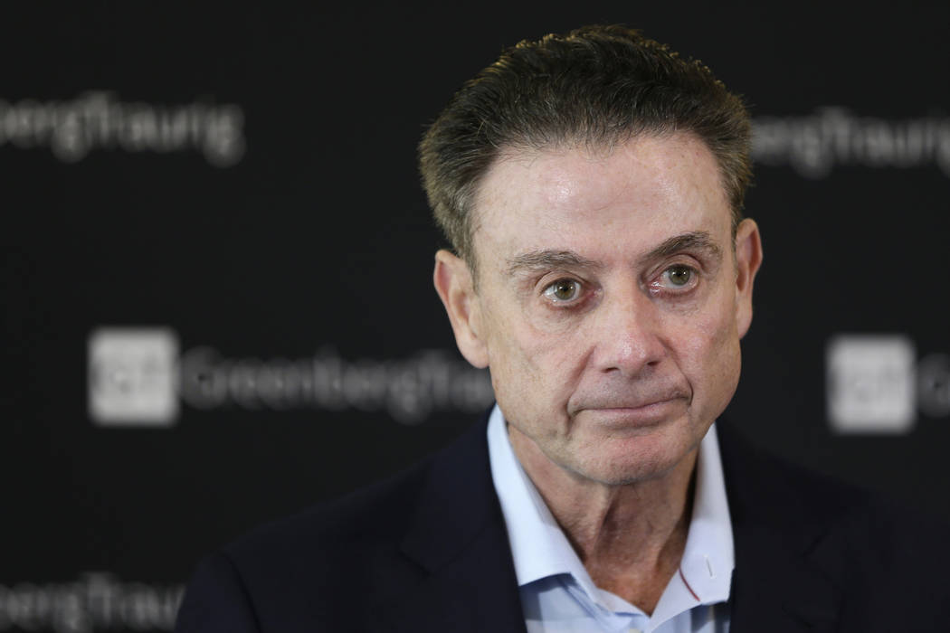 Former Louisville basketball coach Rick Pitino talks to reporters during a news conference in N ...