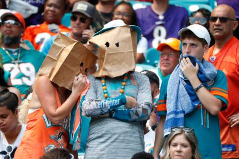 Miami Dolphins fans shows his displeasure with the team during the first half at an NFL footbal ...
