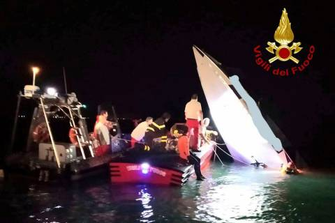This image provided by firefighters shows the wreckage of a racing boat that allegedly smashed ...