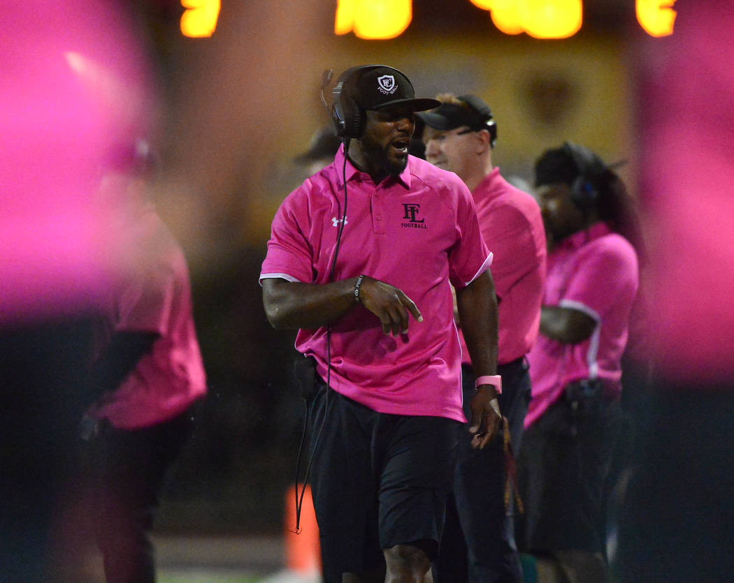 Faith Lutheran head coach Vernon Fox walks the sideline in the first half of a game against Arb ...