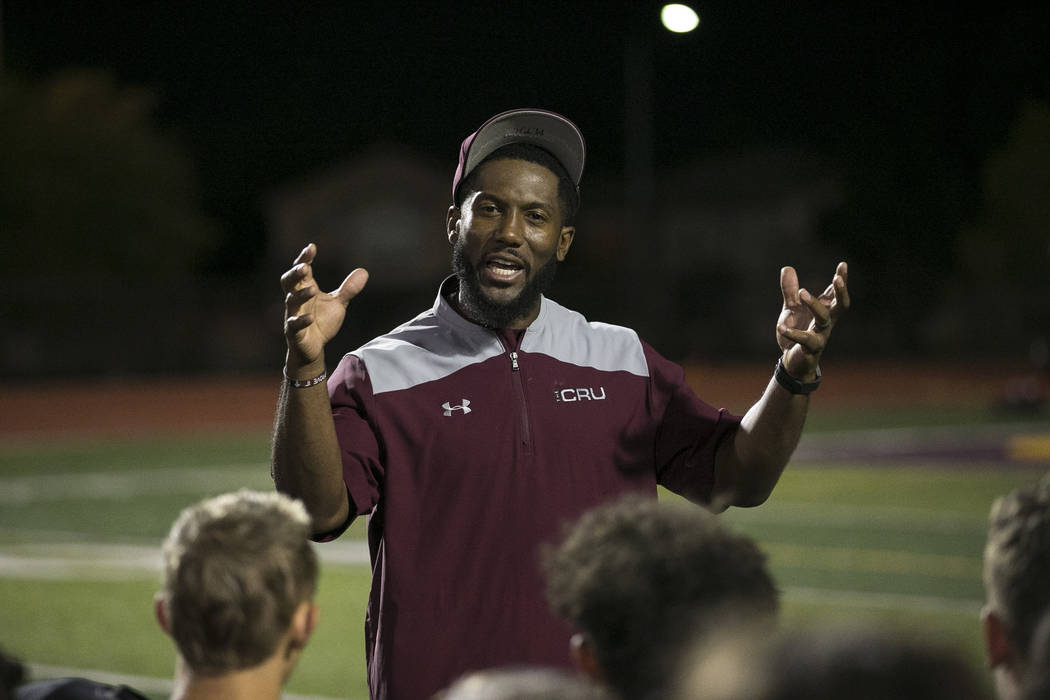 Faith Lutheran football coach Vernon Fox III talks to his team after their loss to Valor Christ ...