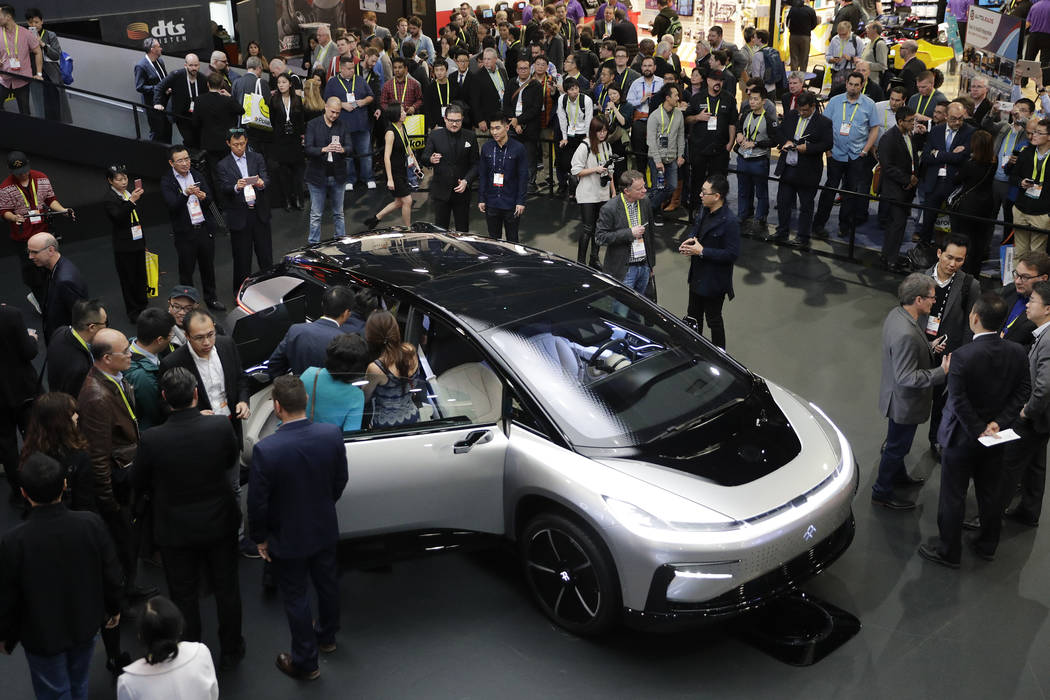 In this Jan. 3, 2017, file photo, Faraday Future's FF 91 electric car is unveiled during a news ...