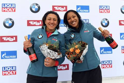 Elana Meyers Taylor, right and Sylvia Hoffmann from the United States celebrate their third pla ...