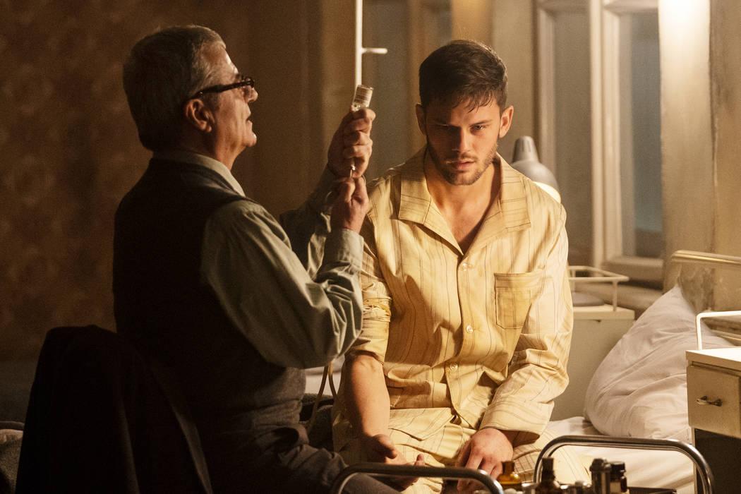 TREADSTONE -- Episode 101 -- Pictured: (l-r) Martin Umbash as Dr. Meisner, Jeremy Irvine as J. ...