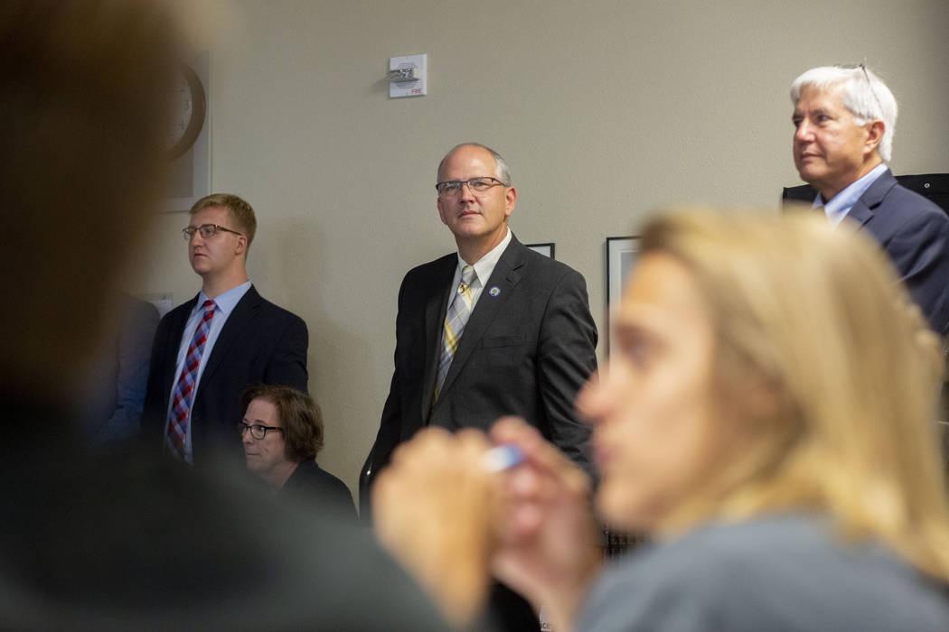 Assistant Doug Burrichtet, left, Assistant U.S. Secretary of Education Scott Stump, center, and ...