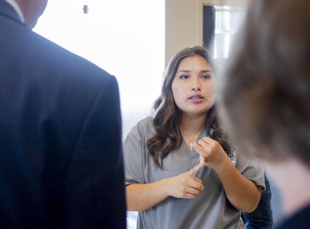 Health information management junior Giselle Lopez, 16, gives a tour to individuals representin ...