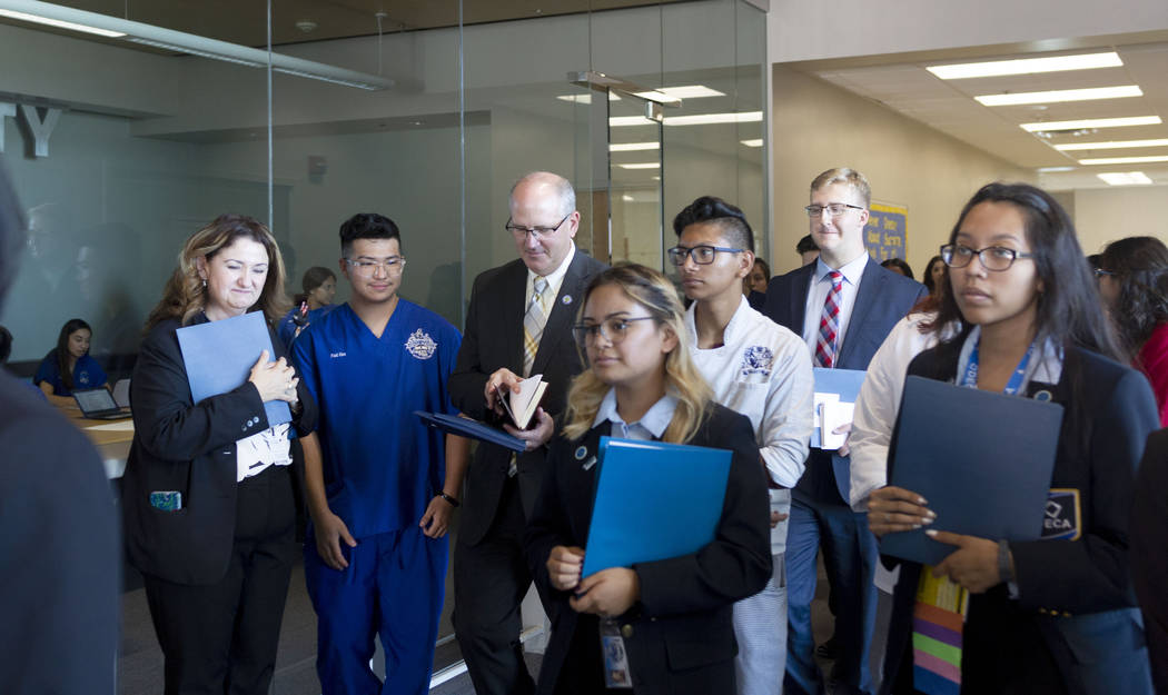 Individuals representing the United States Department of Education receive a tour of East Caree ...