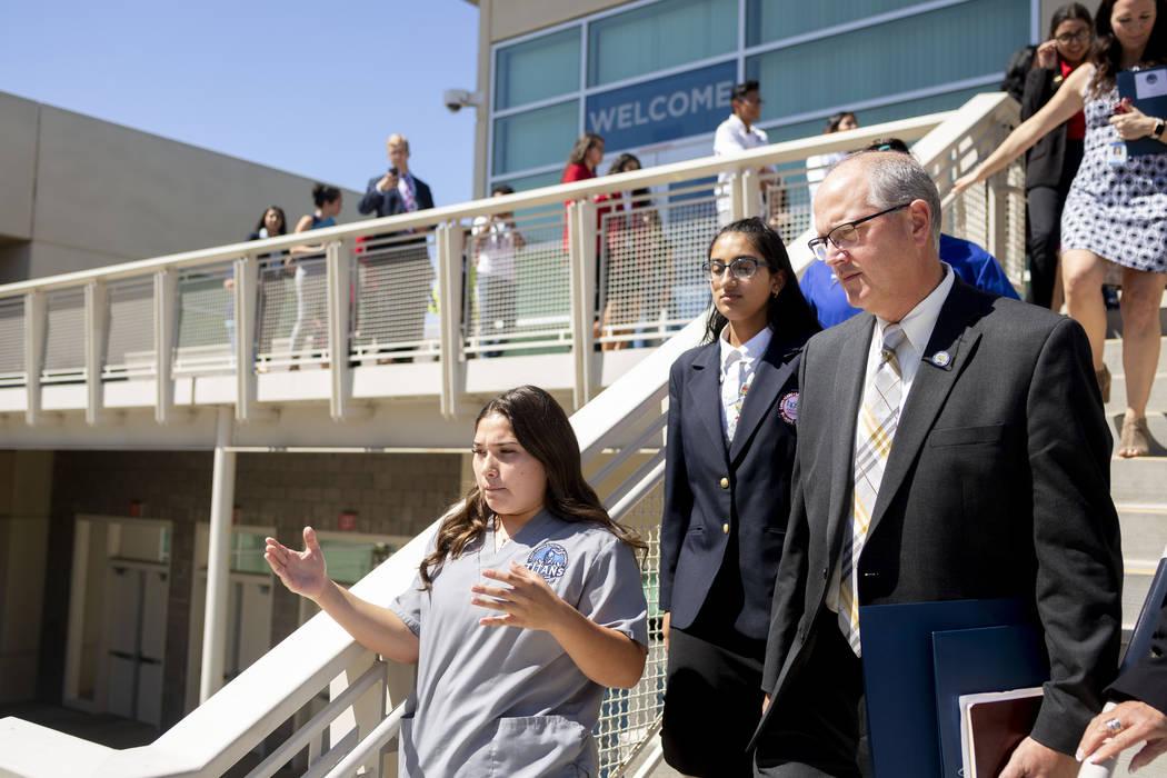 Health information management juniors Giselle Lopez, 16, left, and Ritika Joshi, 16, center, gi ...