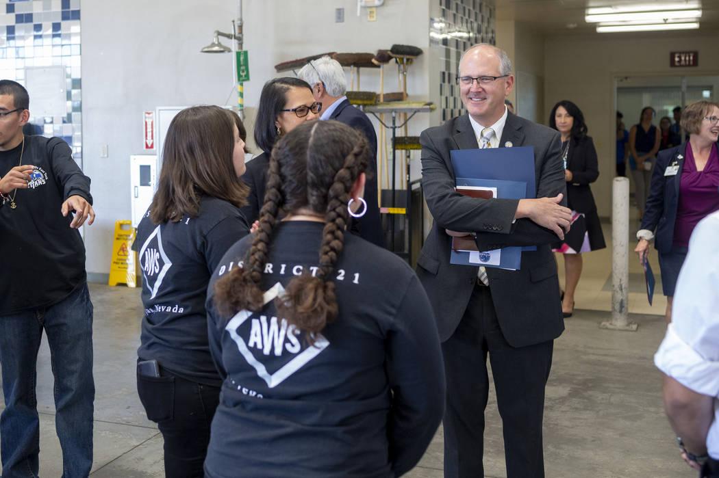 Assistant U.S. Secretary of Education Scott Stump, right, visits a welding and mechanics class ...