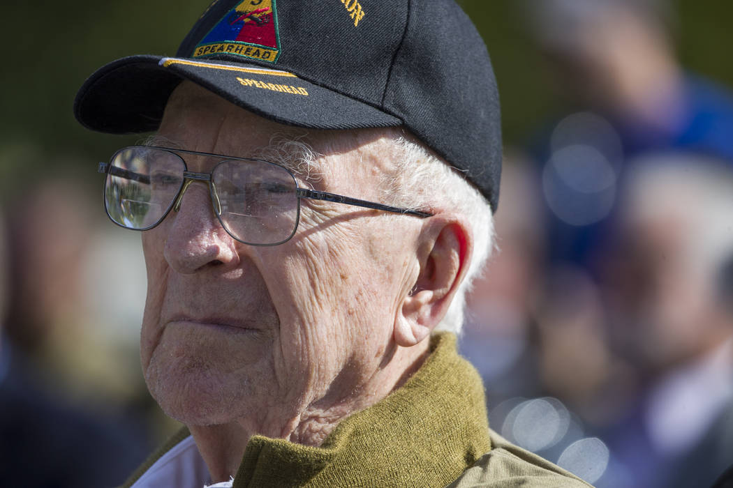 World War II veteran Clarence Smoyer, 96, sits before receiving the Bronze Star at the World Wa ...