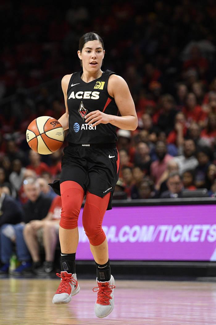 Las Vegas Aces guard Kelsey Plum dribbles the ball against the Washington Mystics during the se ...