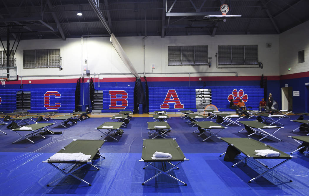 Cots fill the gym at Cedarbridge Academy which will be used as a shelter during the passing of ...