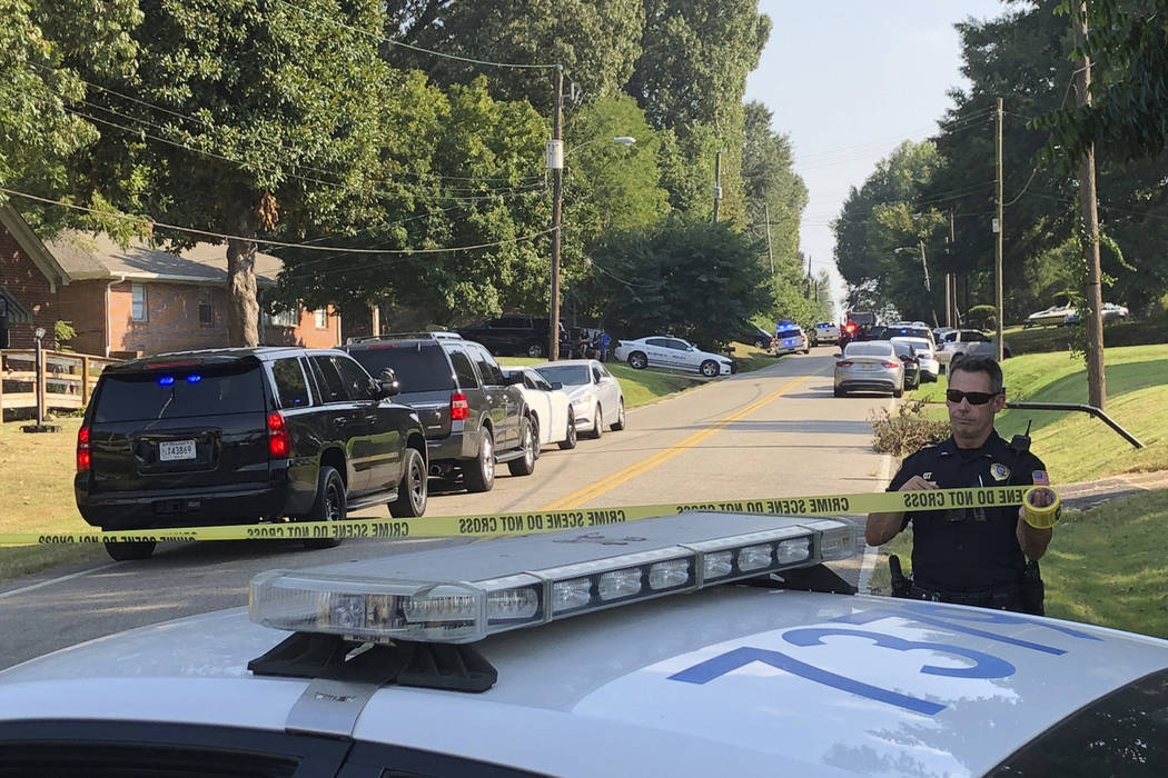 Police cordon off the scene of a shooting in Memphis, Tenn., on Wednesday, Sept. 18, 2019. Offi ...