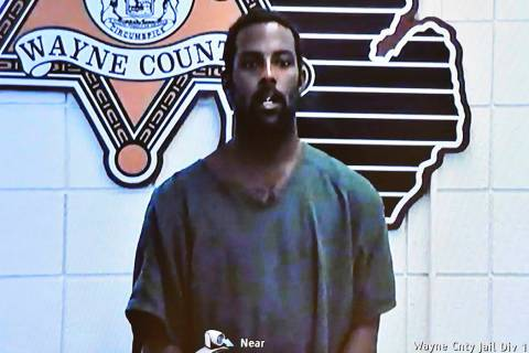 Deangelo Martin is displayed on a monitor during his video arraignment at 36th District Court, ...
