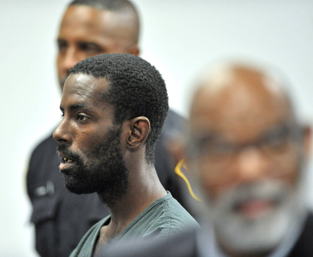 FILE - In this June 20, 2019 file photo, Deangelo Martin stands for a probable cause hearing, i ...