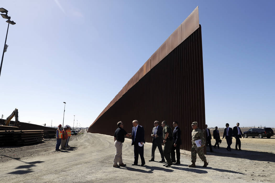 President Donald Trump tours a section of the southern border wall, Wednesday, Sept. 18, 2019, ...