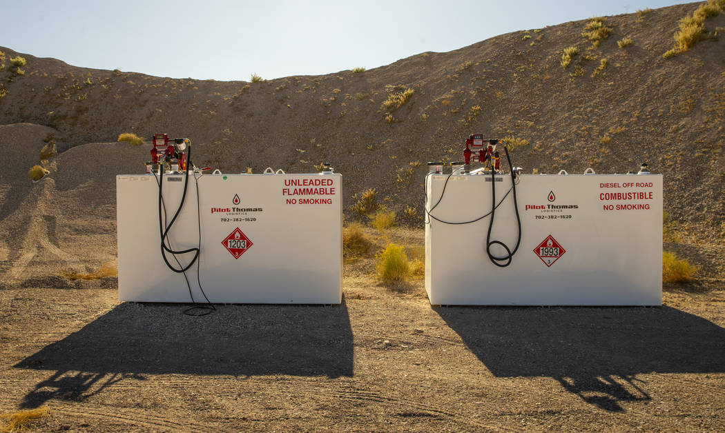 Gas tanks are staged for emergency vehicles at the Incident Command Post in the Tikaboo Valley ...