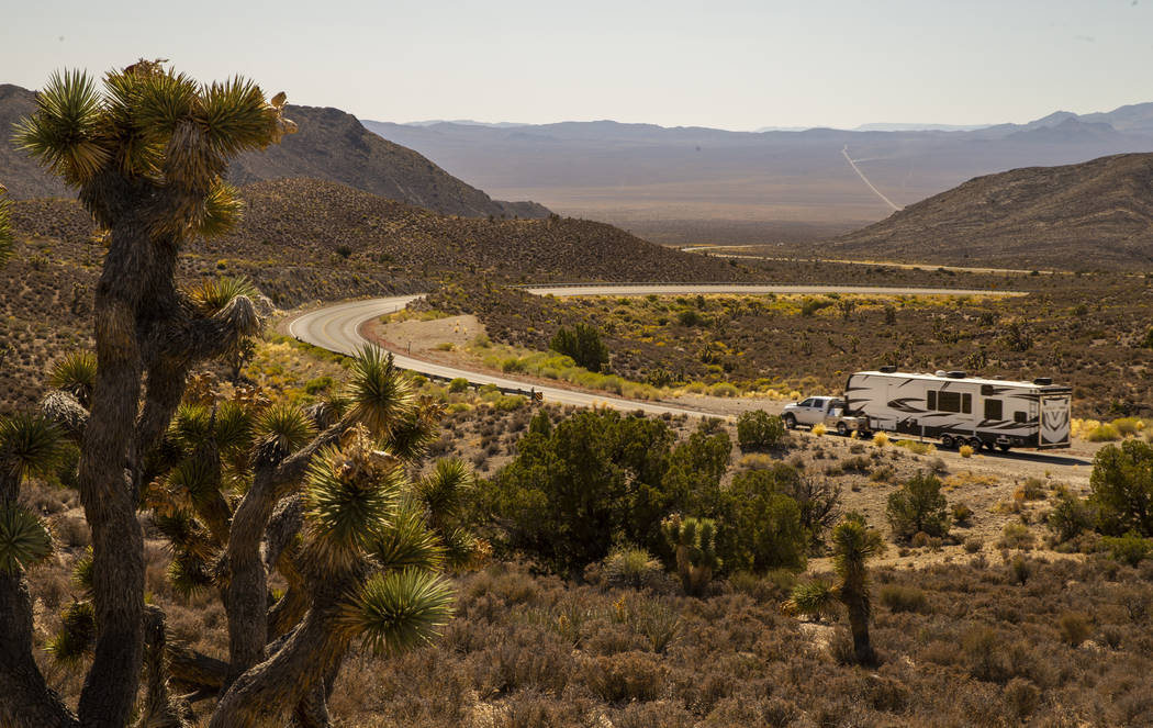 A camper heads over the Hancock Summit along the Extraterrestrial Highway which could be a chok ...
