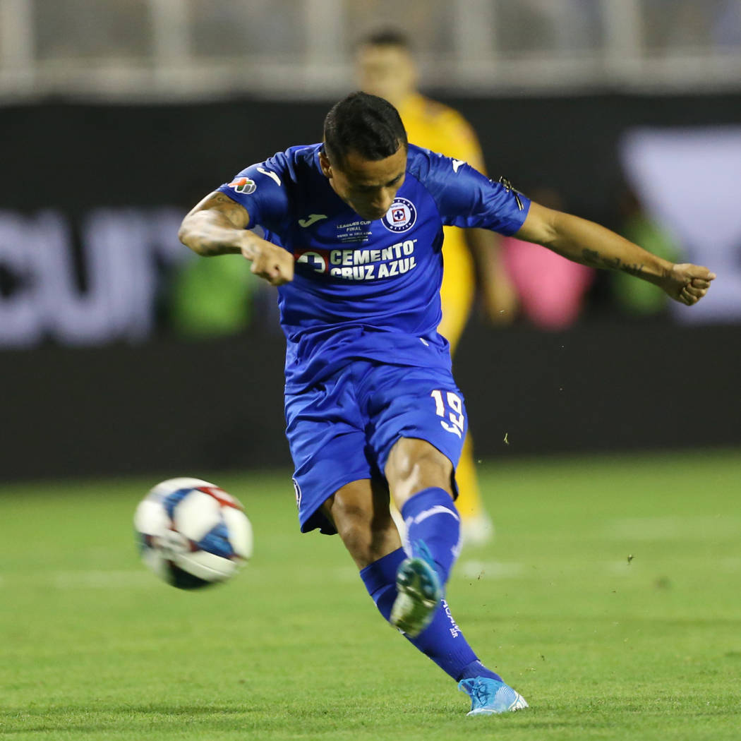 Cruz Azul's Yoshimar Yotun (19) takes a shot against Tigres during the first half of the League ...