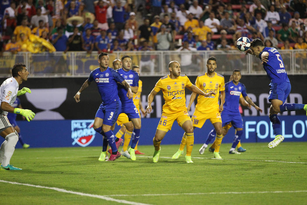 Cruz Azul's Igor Lichnovsky (5) heads the ball wide of the goal against Tigres during the first ...