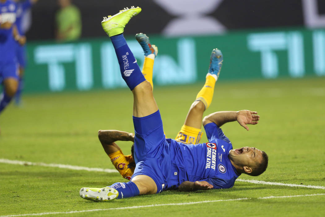 Cruz Azul's Pablo Aguilar (23) falls to the ground after making contact with Tigres' Javier Aqu ...