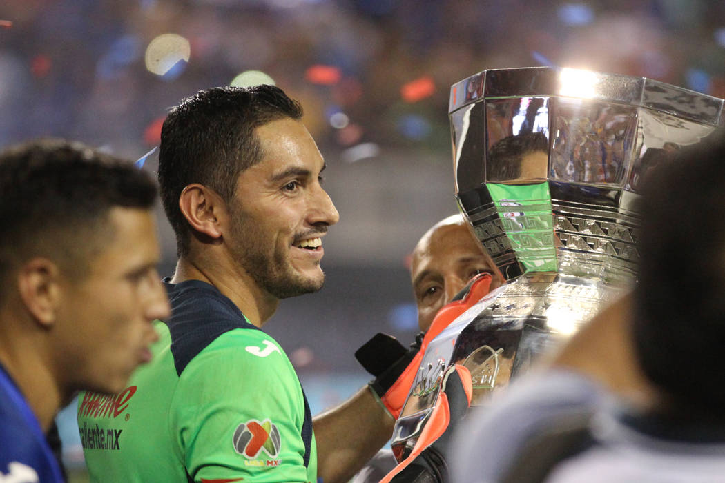 Cruz Azul's Jesus Corona (1) holds up the trophy after his team's win 2-1 against Tigres in the ...