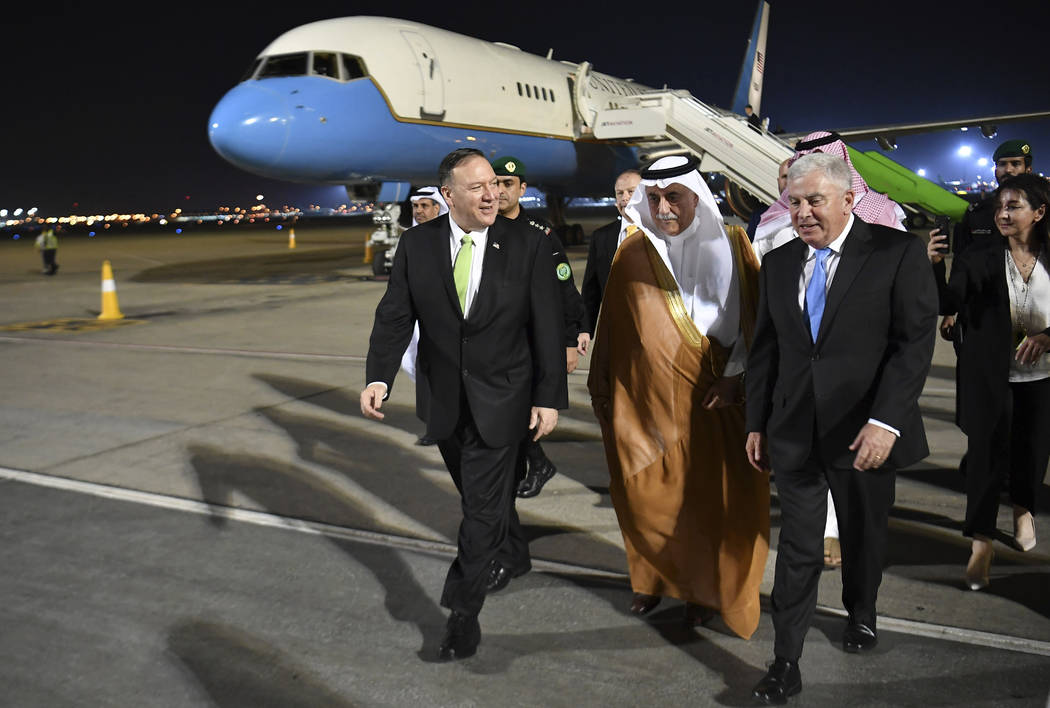 Secretary of State Mike Pompeo walks after stepping off his plane upon arrival at King Abdulazi ...