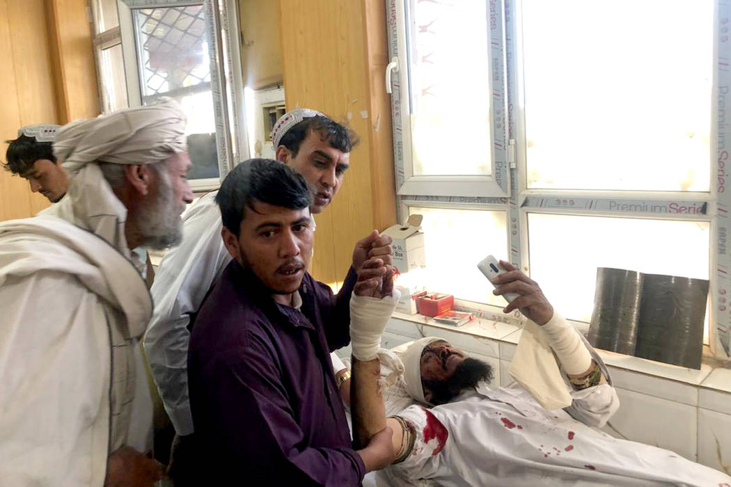 An injured man receives treatment at a hospital after a suicide attack in Zabul, Afghanistan, T ...