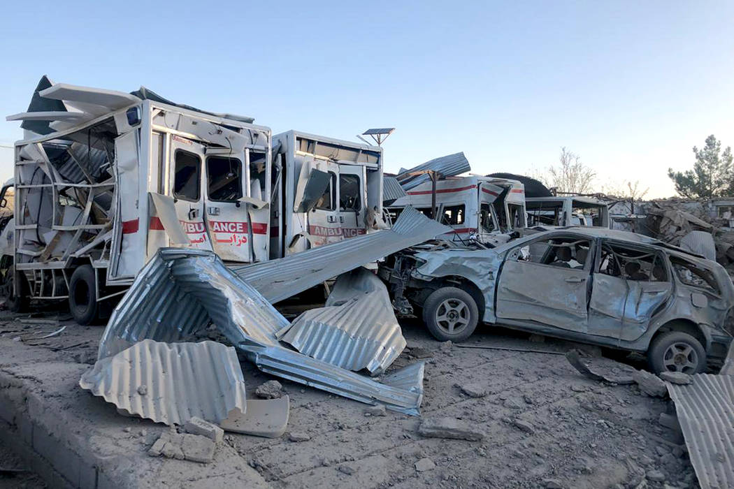 Damaged cars are seen at the site of a suicide attack in Zabul, Afghanistan, Thursday, Sept. 19 ...