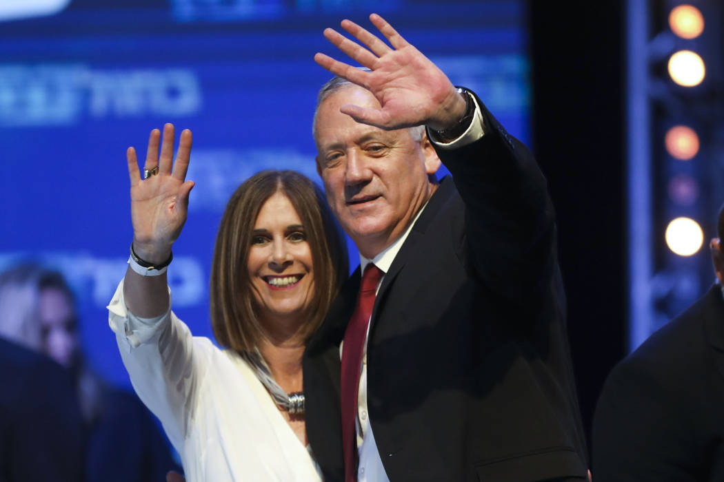 Blue and White party leader Benny Gantz and his wife Revital wave to supporters at party headqu ...
