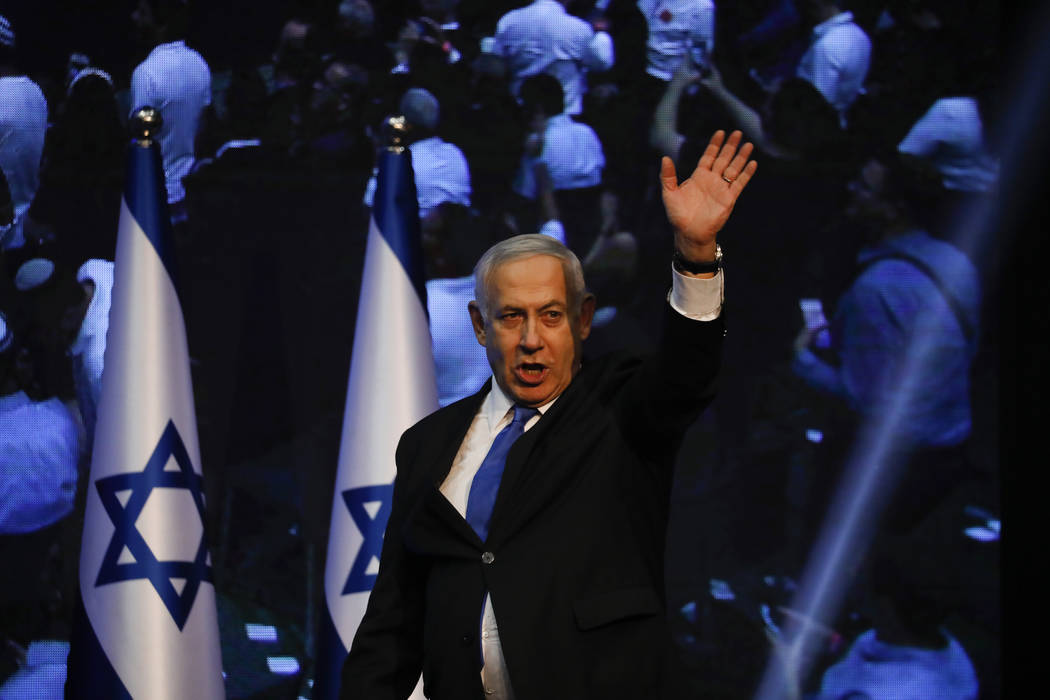 Israeli Prime Minister Benjamin Netanyahu addressees his supporters at party headquarters after ...