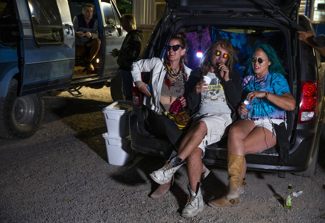 Marge Lemay, left, Martin Bo Jarski and Karen Peterson relax in a van outside the Little A'Le'I ...