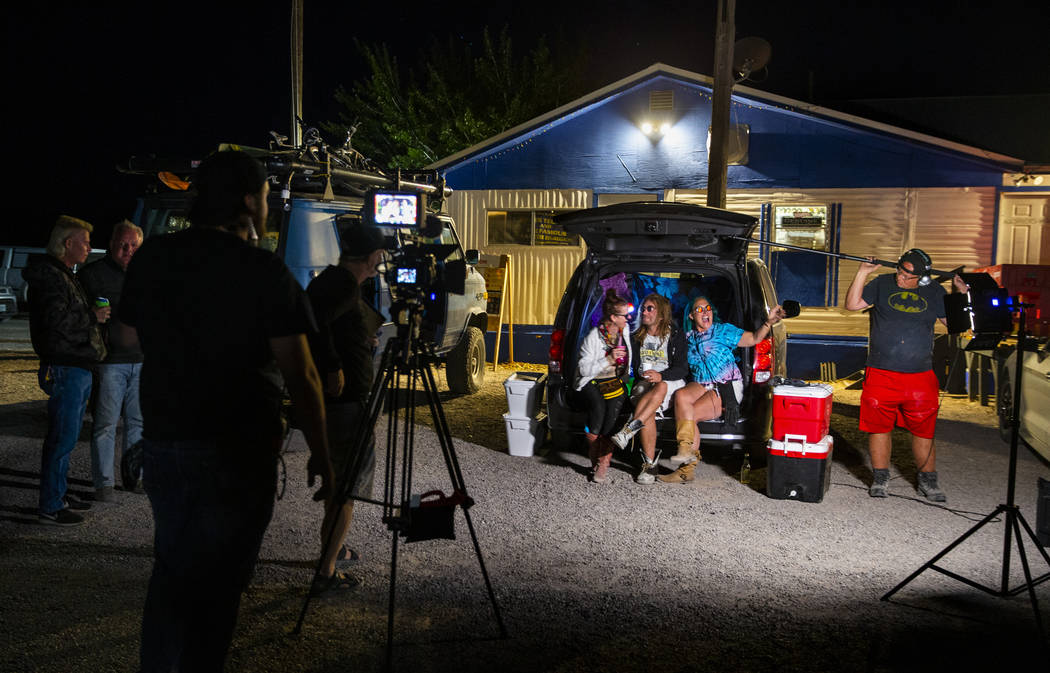 Marge Lemay, left, Martin Bo Jarski and Karen Peterson give an interview while relaxing in a va ...