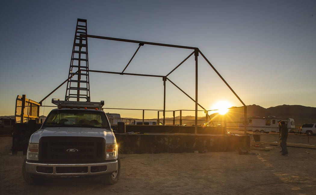The sun comes up on the main stage while the construction crew begins to stir as the start of t ...