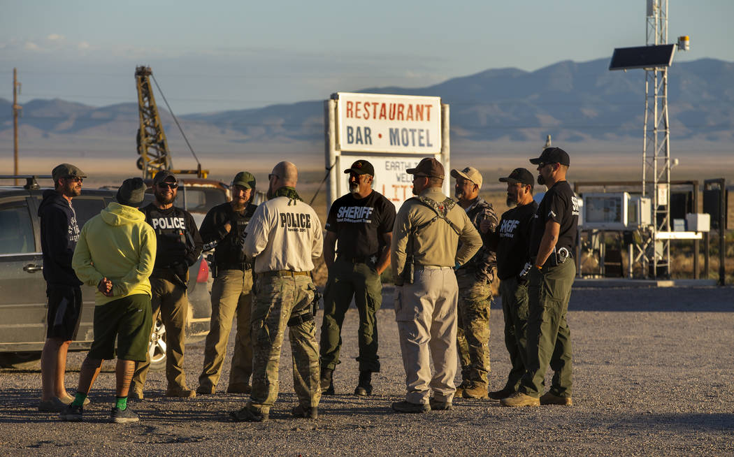 Law enforcement officers gather outside the Little A'Le'Inn, which closed Thursday before the s ...
