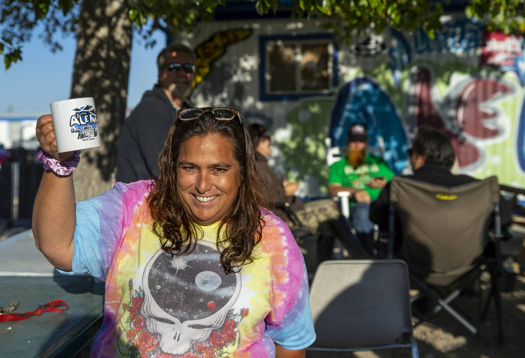 Connie West of the Little A'Le'Inn greets the day as the restaurant behind will serve coffee an ...