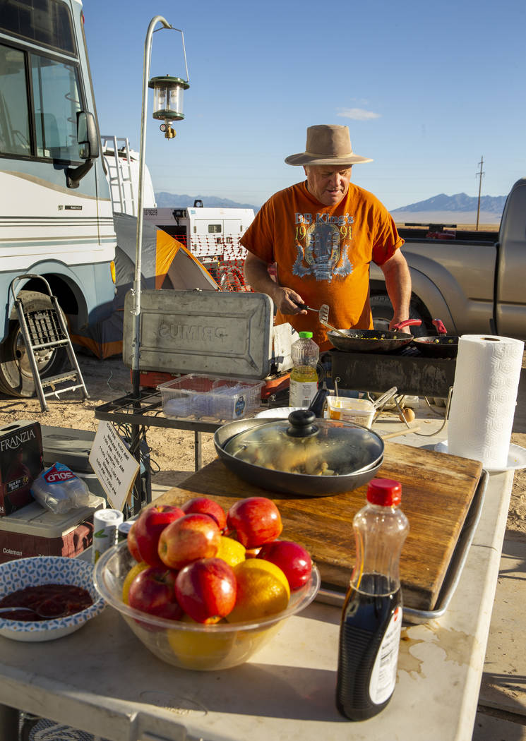 George Morrow cooks up breakfast for the stage construction crew as the start of the Alienstock ...