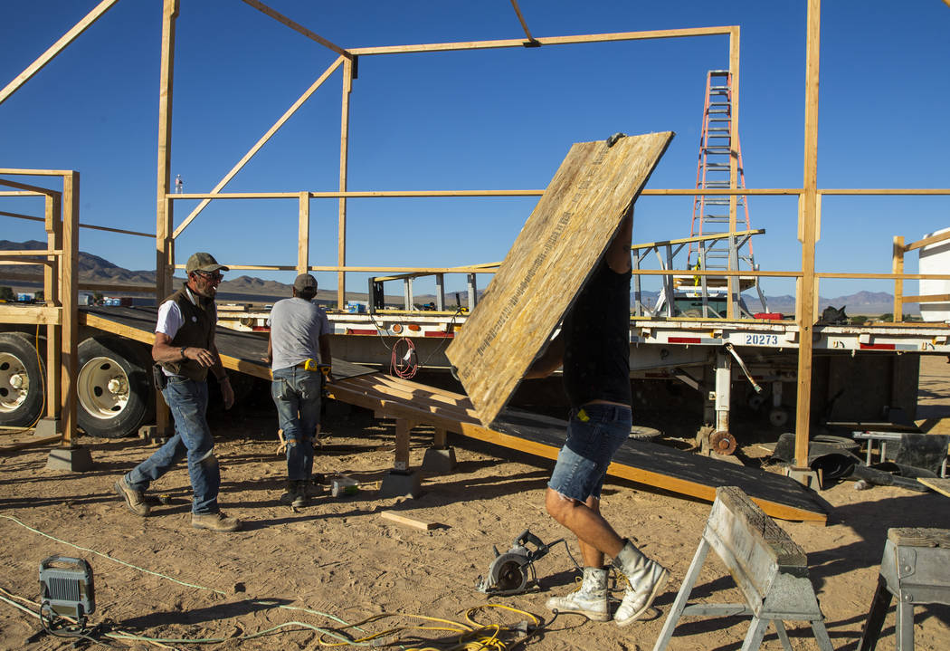 The construction crew begins work on finishing the main stage as the start of the Alienstock fe ...