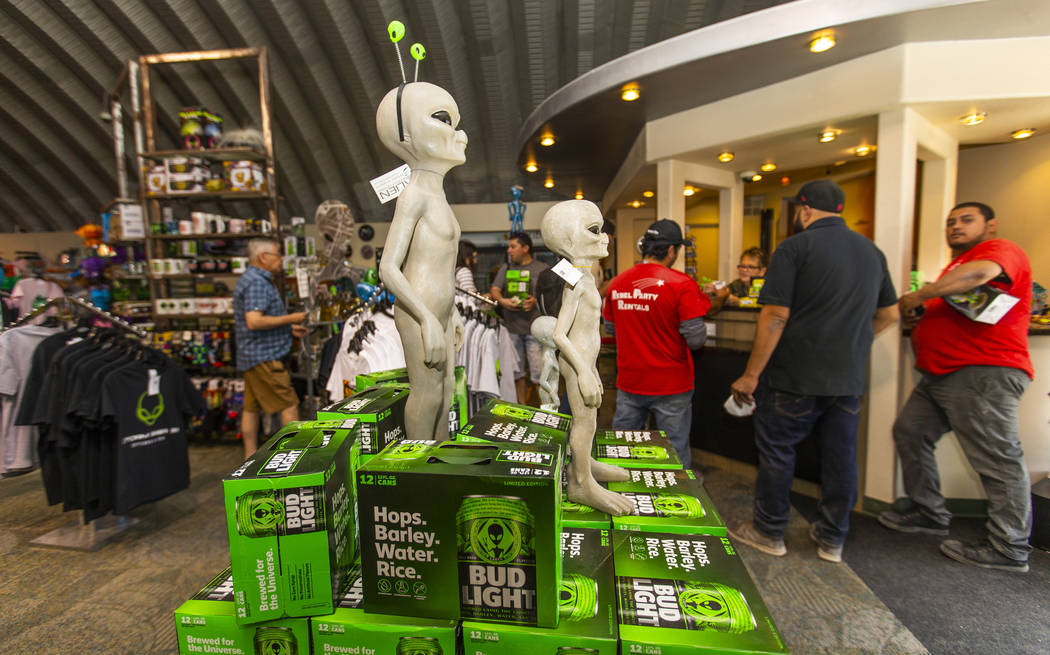 Customers line up for merchandise in the Alien Research Center which is the home of the Area 5 ...