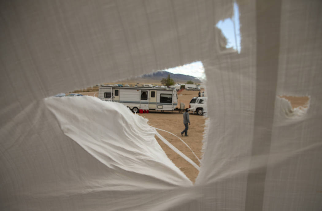 Rips in the main stage roof tarp are increasing while the winds pick up near the start of the A ...