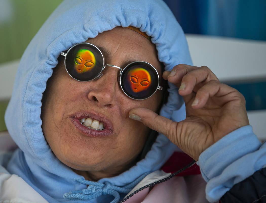 Festivalgoer Karen Peterson sports some alien sunglasses as the start of the Alienstock festiva ...