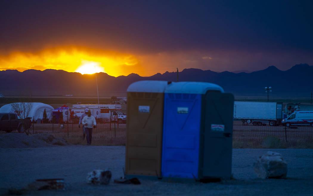 The sun sets on festivalgoers as the start of the Alienstock festival nears on Thursday, Sept. ...