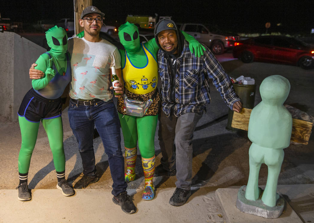 Festivalgoers Michael Solarzano, left, and James Bivens hang out with some aliens at the Little ...