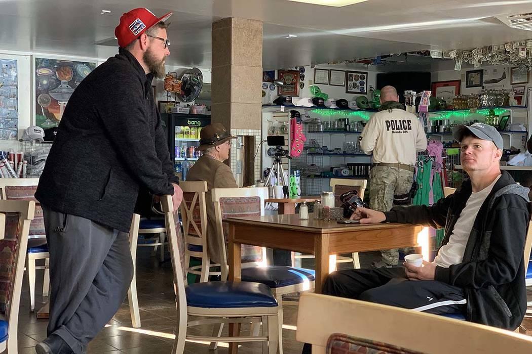 Dustin Goodwin, left, of Houston, met up with his friend Jared Sheldon of Oklahoma City, sittin ...