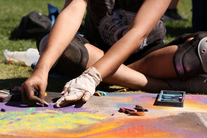 Gabby Antonio works on her chalk art in part of Chalk and Cheers at Skye Canyon Park in Las Veg ...