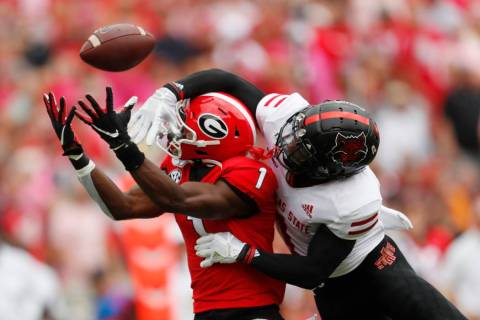 Arkansas State cornerback Jerry Jacobs, right, breaks up a pass intended for Georgia wide recei ...