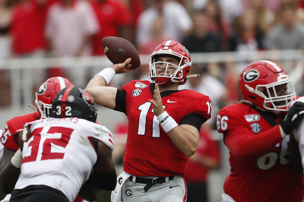 Georgia quarterback Jake Fromm (11) throws from the pocket in the first half of an NCAA college ...
