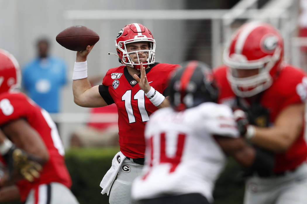 Georgia quarterback Jake Fromm (11) throw from the pocket against Arkansas State in the first h ...