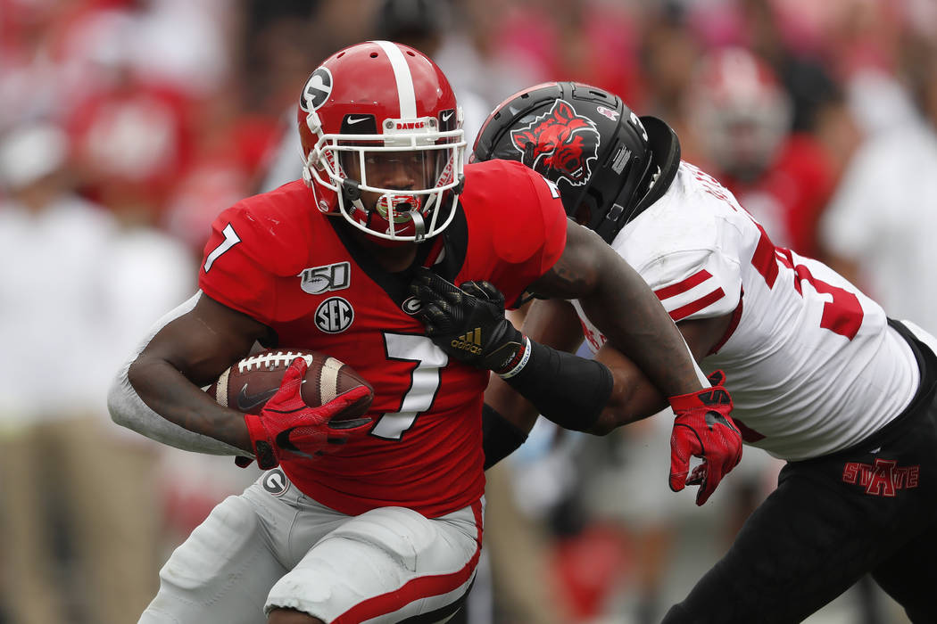 Georgia running back D'Andre Swift (7) is tackled by Arkansas State defensive back Darreon Jack ...