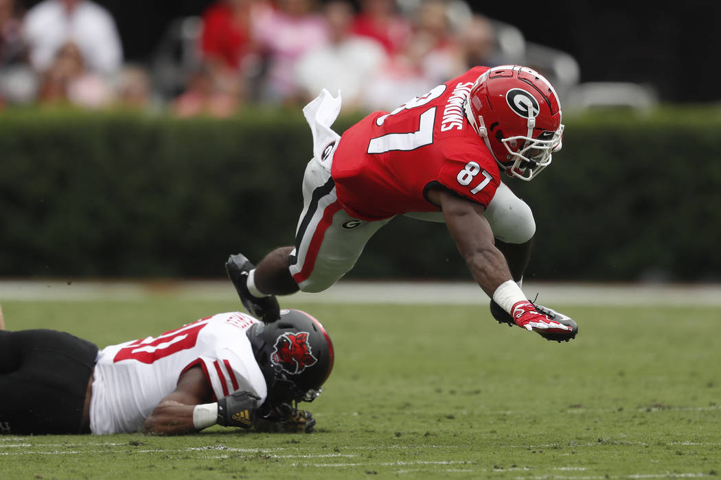 Georgia wide receiver Tyler Simmons (87) is stopped by Arkansas State defensive back Detravion ...